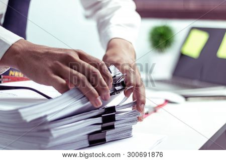Businessmen Are Searching For Documents Lying On The Table,business Report Papers,important Document