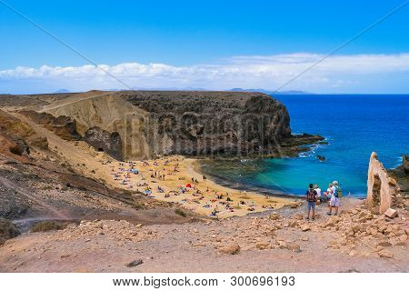 Lanzarote, Canary Islands - April 24, 2019: People At The Beautiful Beach Playa De Papagayo In Lanza