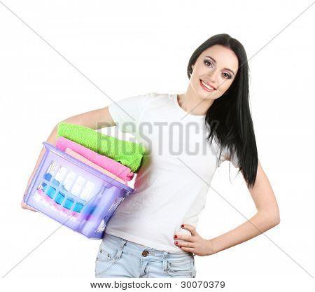 beautiful young girl holding basket of laundry isolated on white