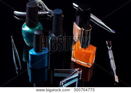 poster of Manicure and pedicure tools on black background, isolated. Equipment for beauty shop, cosmetic salon or beauty parlour. Manicure tools in the beauty salon. Equipment for manicure or pedicure salon.