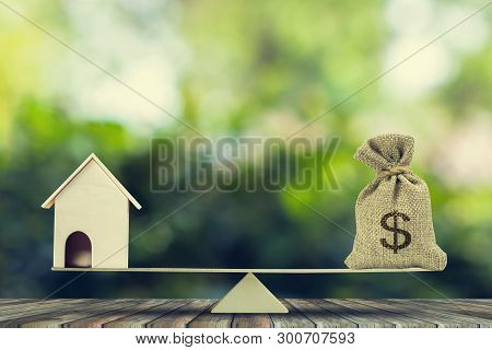 Money And Home,loan,mortgage. Change Home Into Cash Concept. Us Dollar In Sack Bag, Wooden House Mod