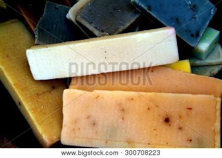 Quadrangular Pieces Of Soap Of Various Colors Displayed On Newsprint Paper Grouped By Colors: Brown-