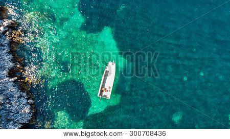 Drop Down View Of Fishing Boats Anchored In Bay.