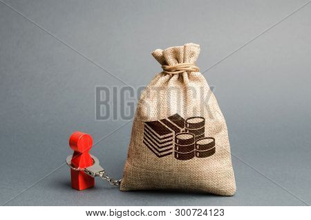A Person Is Handcuffed With A Money Bag. Man Is Addicted To Money, Shopaholic. Money Can Not Buy Hap