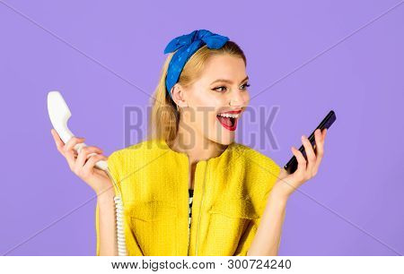 Smiling Woman In Headband Holds Handset&smartphone. Phones Of Different Generations. Pinup Girl With