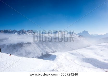 View Of Mountains Through Clouds In Alta Badia, Italy