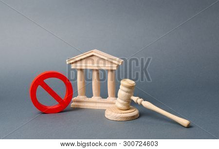 Government Or Bank Building And A Red No Symbol With A Judge Gavel. Declaration Of Default Or Bankru