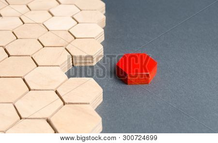 Red Item Is Disconnected From Other Items. Hexagons. The Concept Of Separating Parts From A Whole Or