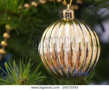 The Christmas-tree Decoration In The Form Of Golden Ball.