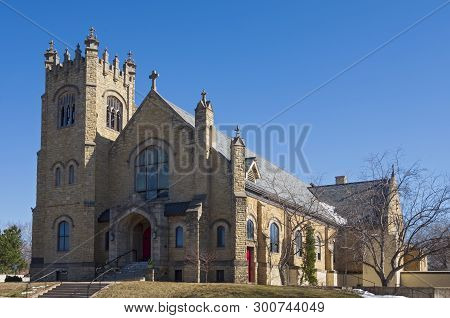 Landmark Church Entrance Bell Tower And Nave Exterior Of Gothic Revival Architectural Style In Saint