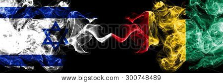 Israel Vs Guinea, Guinean Smoky Mystic Flags Placed Side By Side. Thick Colored Silky Smokes Flag Of