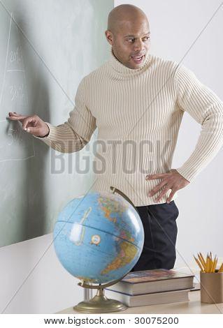Male teacher at chalkboard