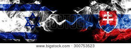 Israel Vs Slovakia, Slovakian Smoky Mystic Flags Placed Side By Side. Thick Colored Silky Smokes Fla