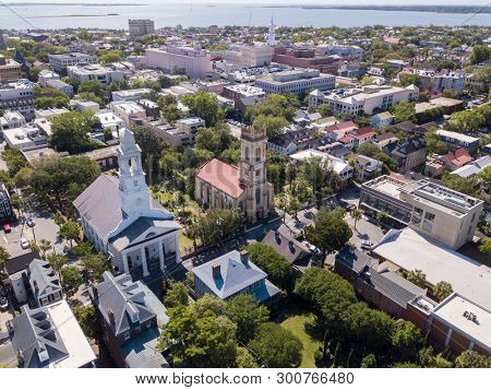 Aerial view of downtown Charleston, South Carolina with St Johns Lutheran and Unitarian churches in foreground.