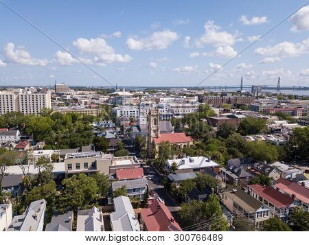 Aerial view of downtown Charleston, South Carolina with historic churches.