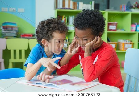Two Boy Kid Sit On Table And Coloring In Book  In Preschool Library,kindergarten School Education Co