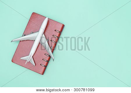 Toy Plane On Top Of Passport On Blue Teal Copy Space