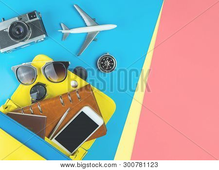 Women Travel Equipment Object Coming Out Of A Purse On Blue Pink Yellow