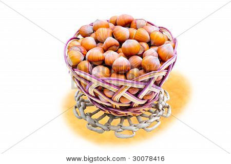 The Woven Basket  With Hazelnuts On Yellow  Support