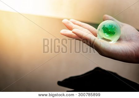 Global Business Or Climate Change Concepts. World Environment Day. Male Hand Holding Green World Glo