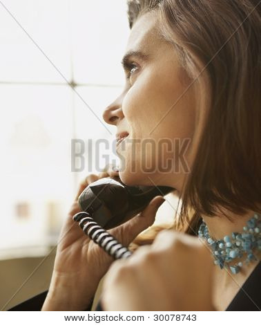 Close up of young woman talking on phone