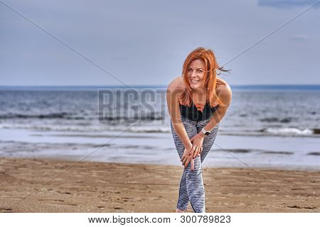 Portrait Of A Middle-aged Woman With Red Hair Walking Along The River Bank. Sunny Spring Morning. Cl