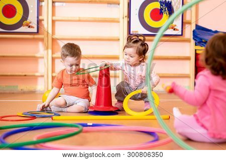 Nursery Babies Toddlers Group Play With Rings In Gym