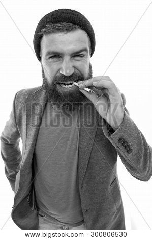Brutal Habits And Lifestyle. Hipster Brutal Bearded Tobacco Smoker. Brutal Unshaven Guy Smoking Isol