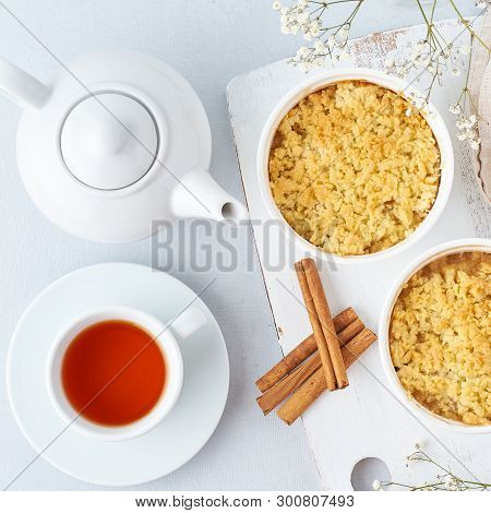 Apple Crumble With Streusel. Morning Breakfast With Tea On Light Gray Table. Top View, Close Up