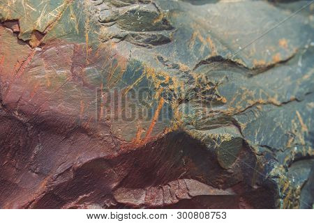 Plane Of Multicolored Boulder In Macro. Beautiful Rock Surface Close Up. Colorful Textured Stone. Am
