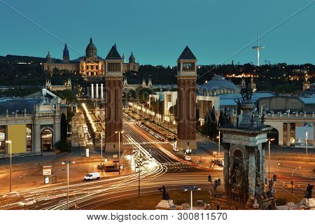 Heavy traffic in Placa Espanya with monumental fountain in Barcelona Spain poster