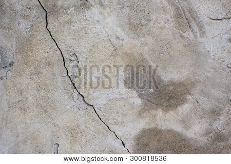 Heterogeneous Gray Concrete Wall Or Floor Background With Crack.