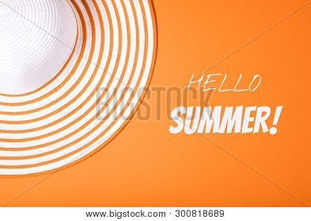 Summer And Vacation Concept. Top View Of Straw Striped Hat On Russet Orange Color Background With In