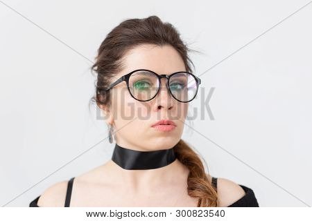 Portrait, fashion, style and people concept - woman in glasses and choker on white background poster