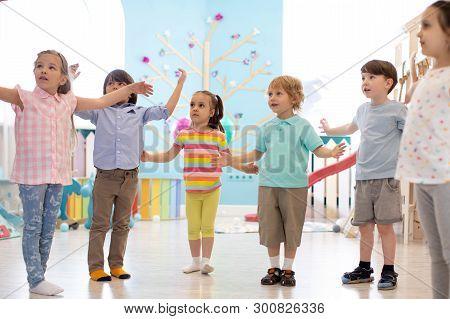 Preschool Kids Practicing Gymnastics In Kindergarten. Childhood And Health Conception