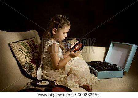 Little Caucasian Girl Holding A Single Disc