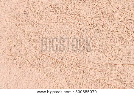 Light brown skin texture, natural or faux leather background. Pinkish leatherette, closeup. poster