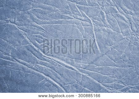 Colored skin texture, natural or faux leather background. Light blue leatherette, closeup. poster