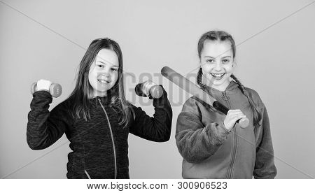 Girls Cute Kids With Sport Equipment Dumbbells And Baseball Bat. We Love Sport. Child Might Excel In