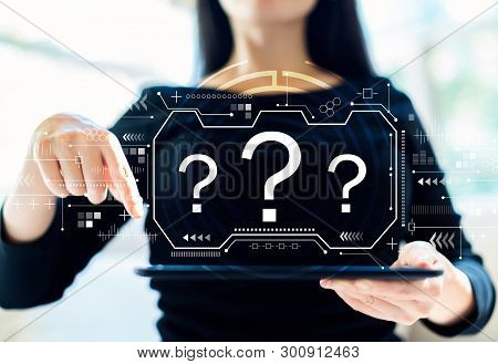 Question Marks With Woman Using Her Tablet