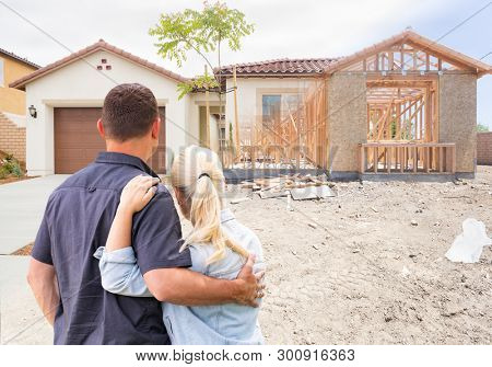 Couple Facing Construction Framing Gradating To Completed Home.