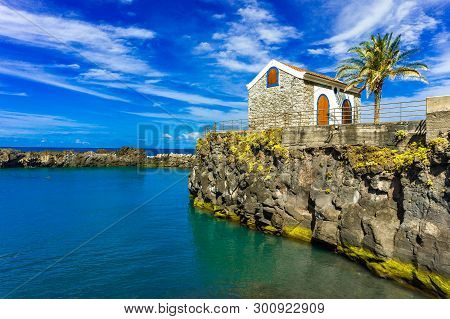 Portugal Small Old House, Tranquil Surface Of The Ocean, Coast Of Madeira Island
