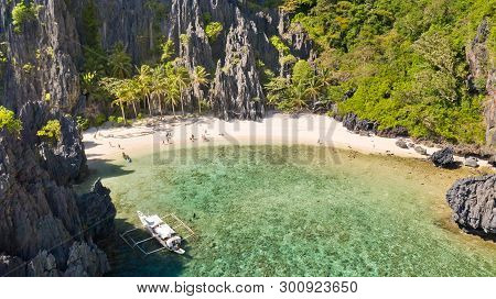 Beautiful Lagoon Surrounded By Cliffs.aerial Drone View Of Swimmers Inside A Tiny Hidden Tropical La