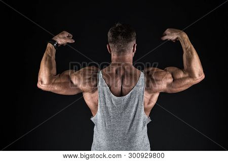 Bodybuilding And Sport. Strength And Shape Concept. Sport And Fitness. Bodybuilder Showing Muscles,