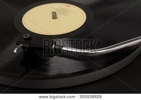 Turntable Black Playing Vinyl Close Up With Needle On The Record. Record Player, Black With Vinyl Re