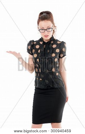 Presenting Something Special. Successful Business Lady Stretching Her Hand Away. Pretty Woman Wearin