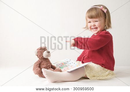 Playing School With Toys. Happy Smiling Baby Girl Elegant In Dress. Cute Caucasian Baby With Teddy B