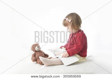 Education Concept. Playing School With Toys. Happy Smiling Baby Girl Elegant In Dress. Cute Caucasia