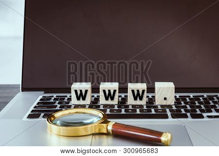 Web Browser Www With Wooden Cube And Magnifying Glass On Laptop Keyboard, Technology Communication A