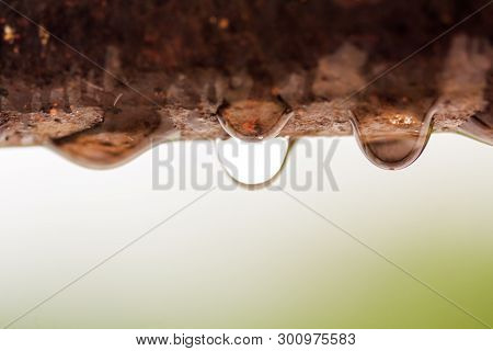 Closeup Of Water Droplets On A Rusty Iron Rod With Out Of Focus Background